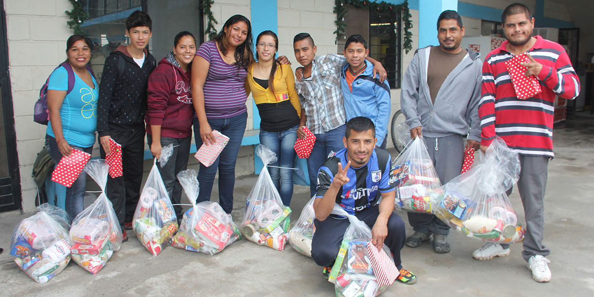Volunteers with their Christmas grocery packages in Reynosa