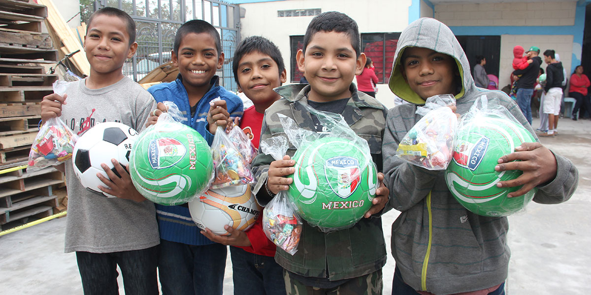 Boys with their new soccer balls at the Christmas fiesta in Reynosa
