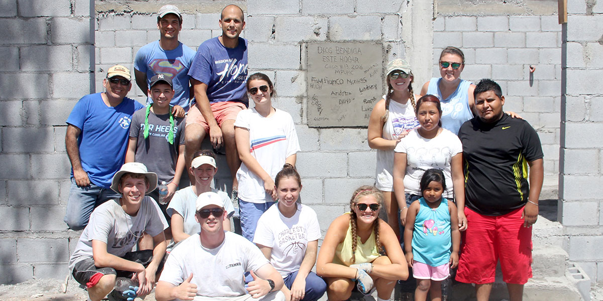 The team and family in front of the completed house in Mexico