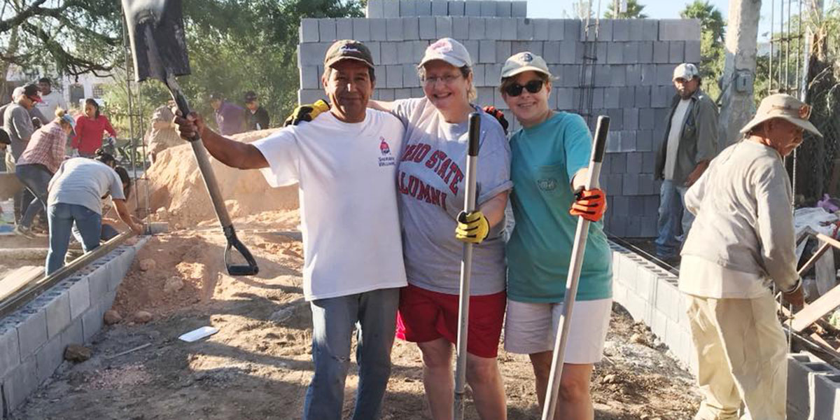 Friends working together to build a house in Reynosa
