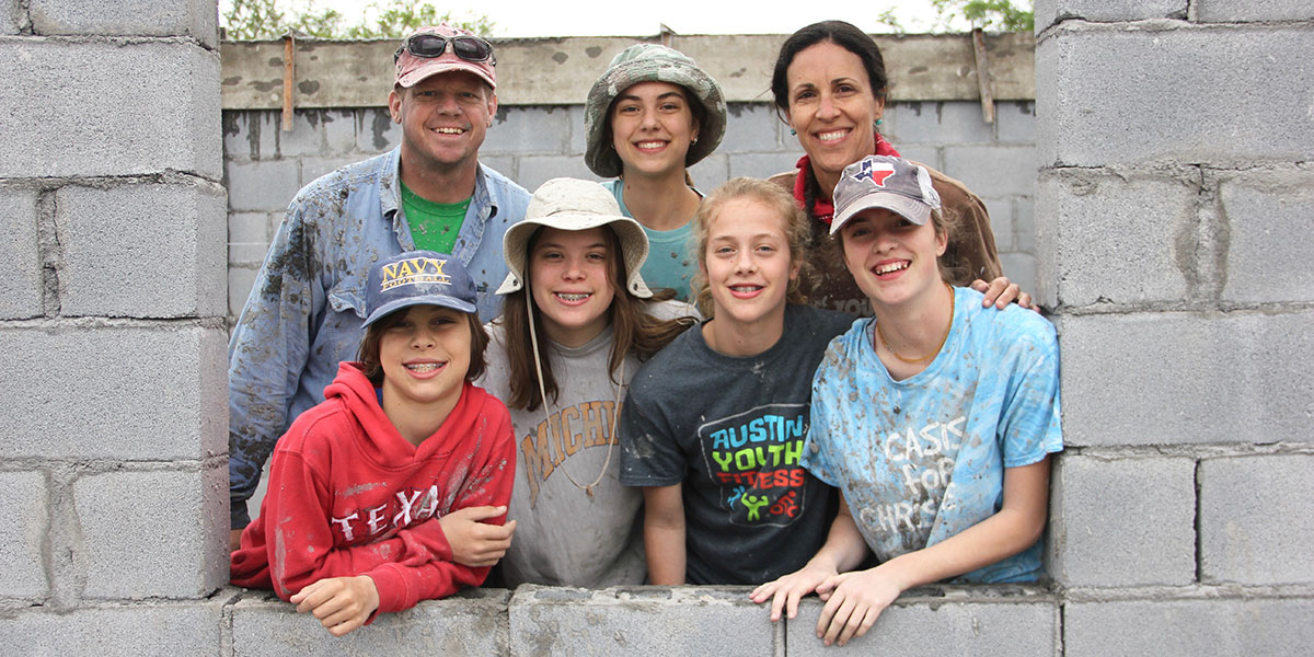 A family working together to build a house in Mexico