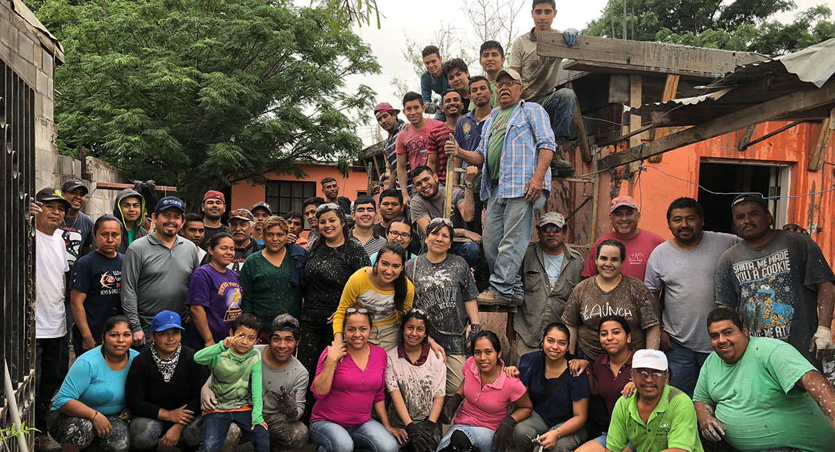 A team from Monterrey with the staff and volunteers after pouring a roof in Reynosa