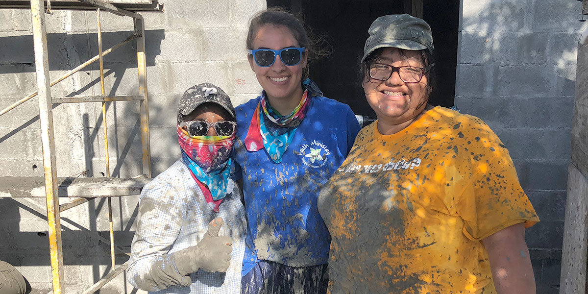 Summer interns with a volunteer after pouring a roof in Reynosa