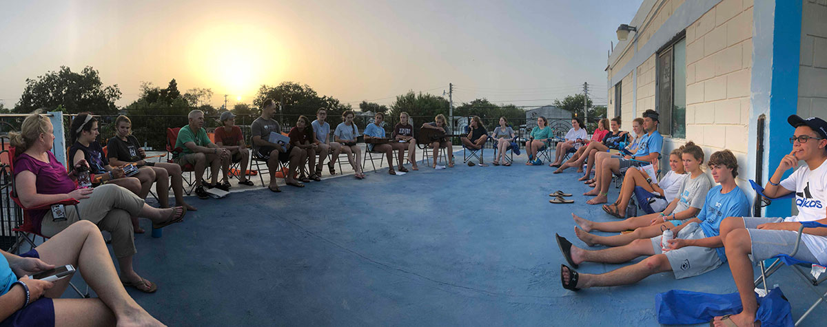 A group from North Carolina enjoys an evening devotion at sunset on the rooftop in Reynosa