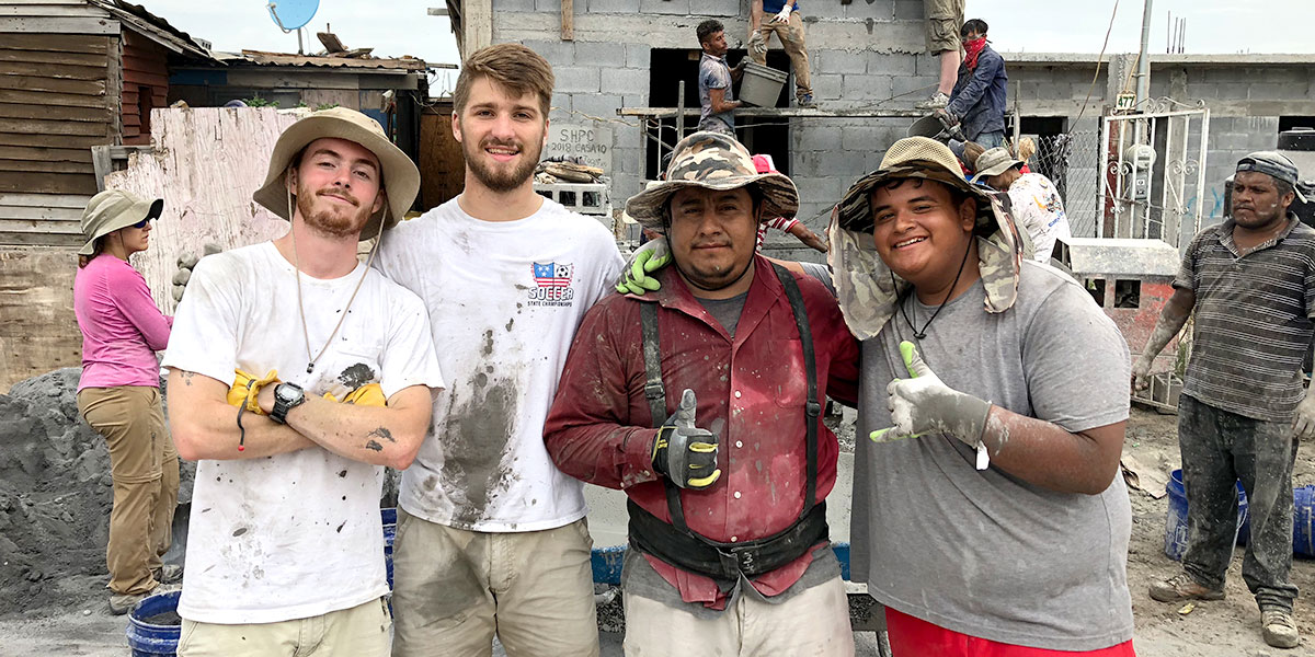 Luke and his fellow intern and Mexican friends pouring a roof in Reynosa