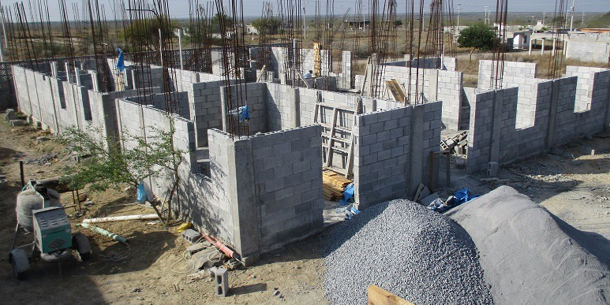 The walls of the community center being built in February 2016