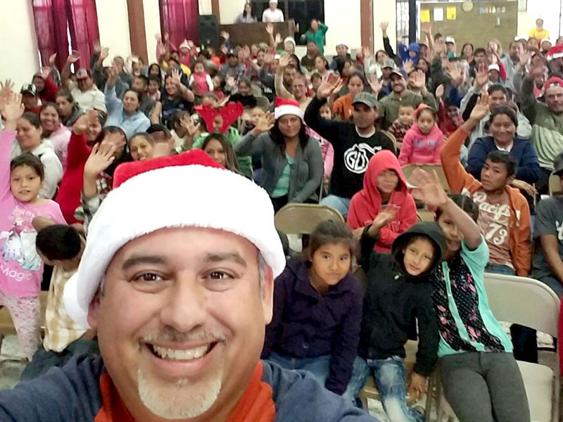 David and the community at the Christmas fiesta