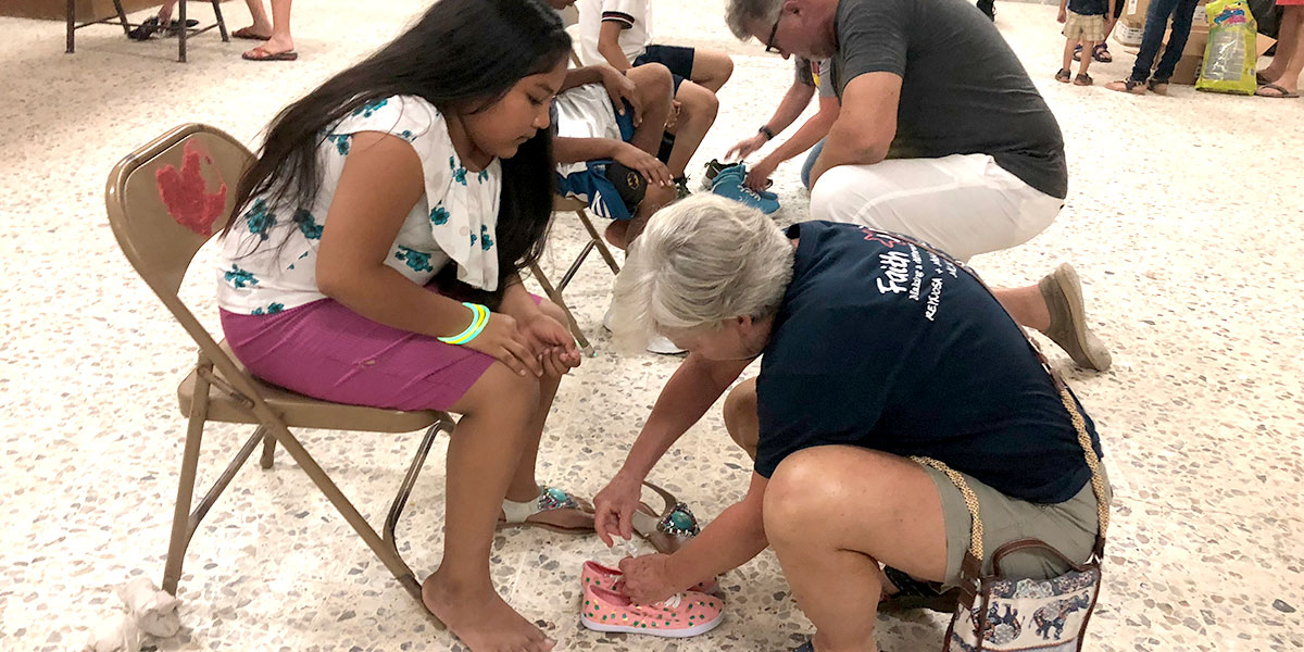A team in Alabama fitting kids for new shoes in Reynosa