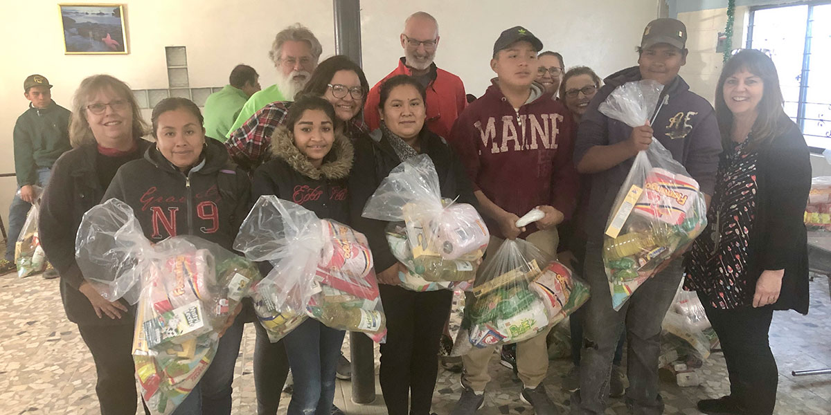 Giving away grocery packages to volunteers in Reynosa