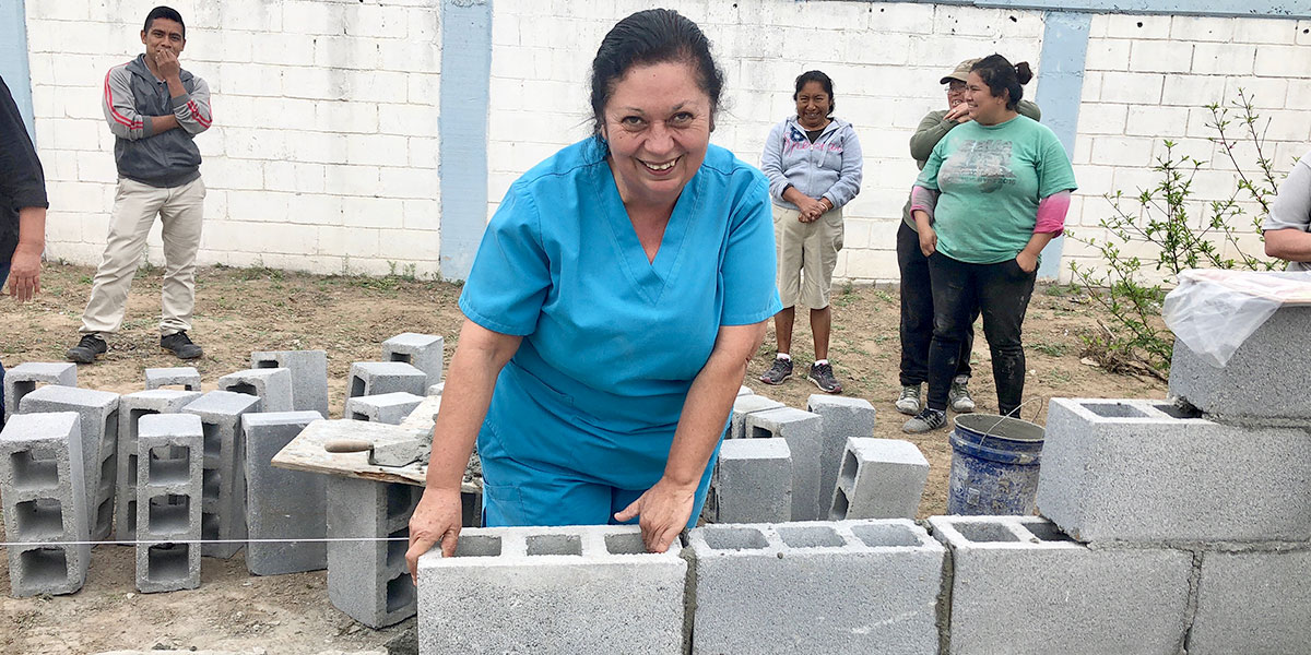 Betty laying one of the first blocks at the Deantin community center in Naranjito