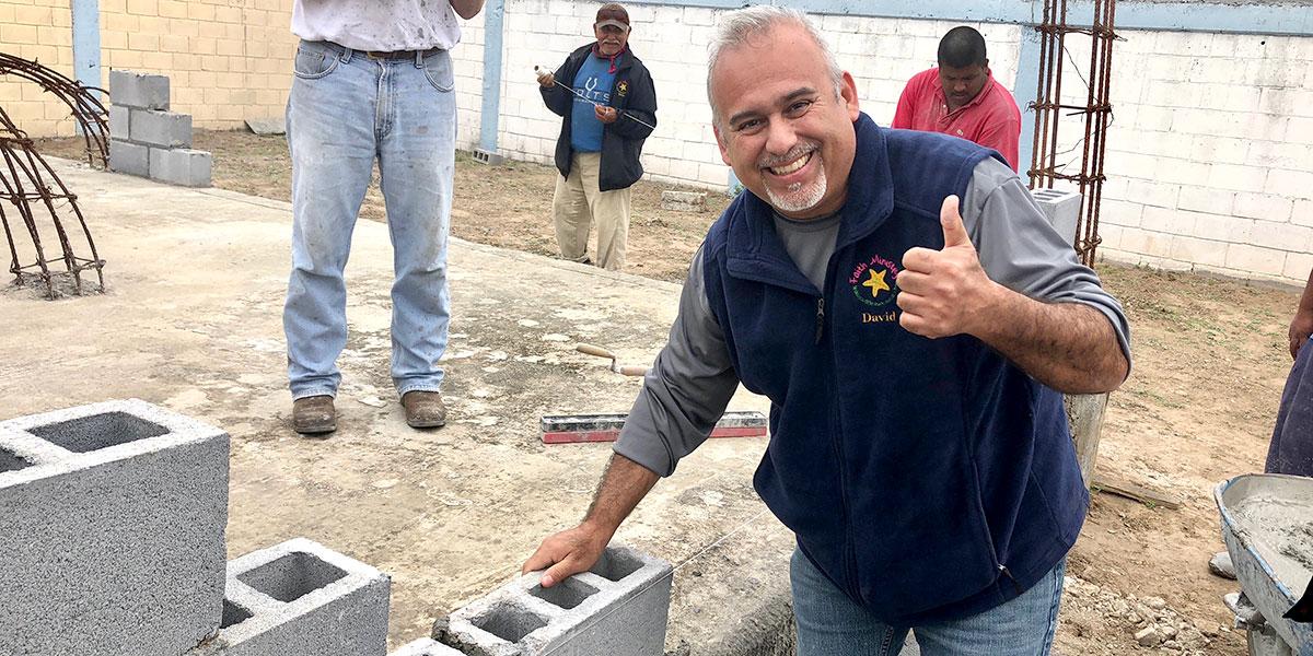 David laying the first block at the Deantin community center in Naranjito