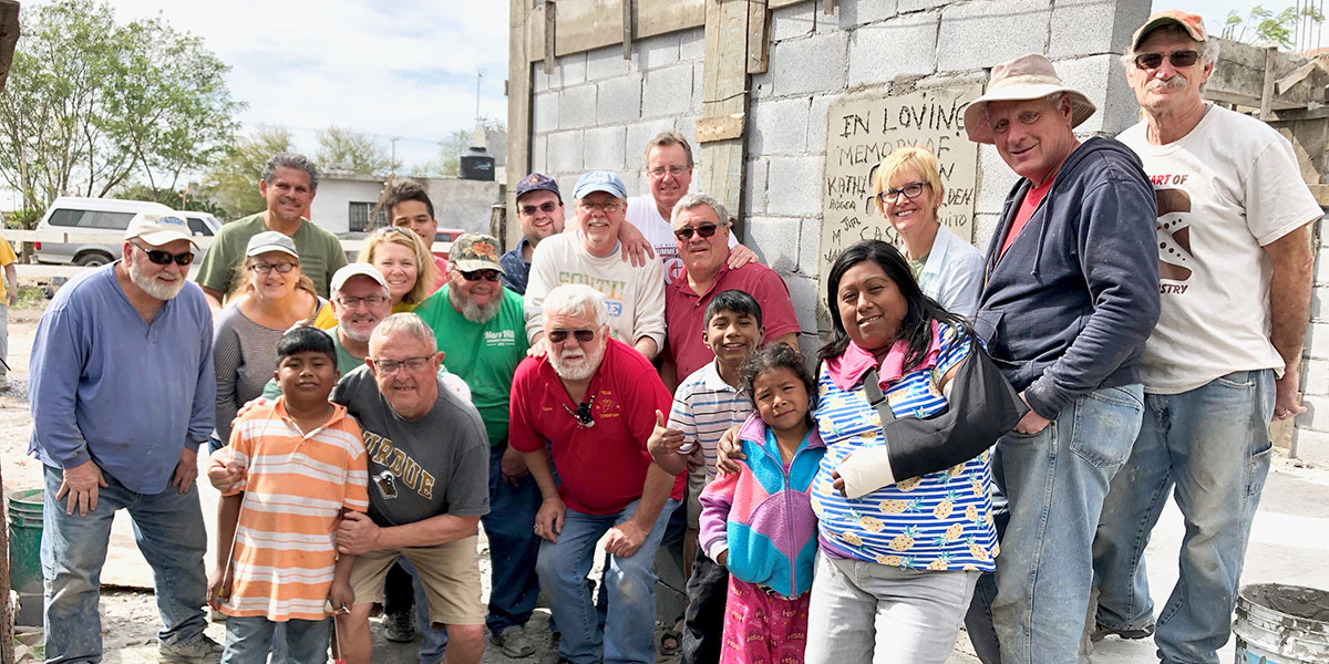A team from Indiana with the family receiving a new house in Reynosa