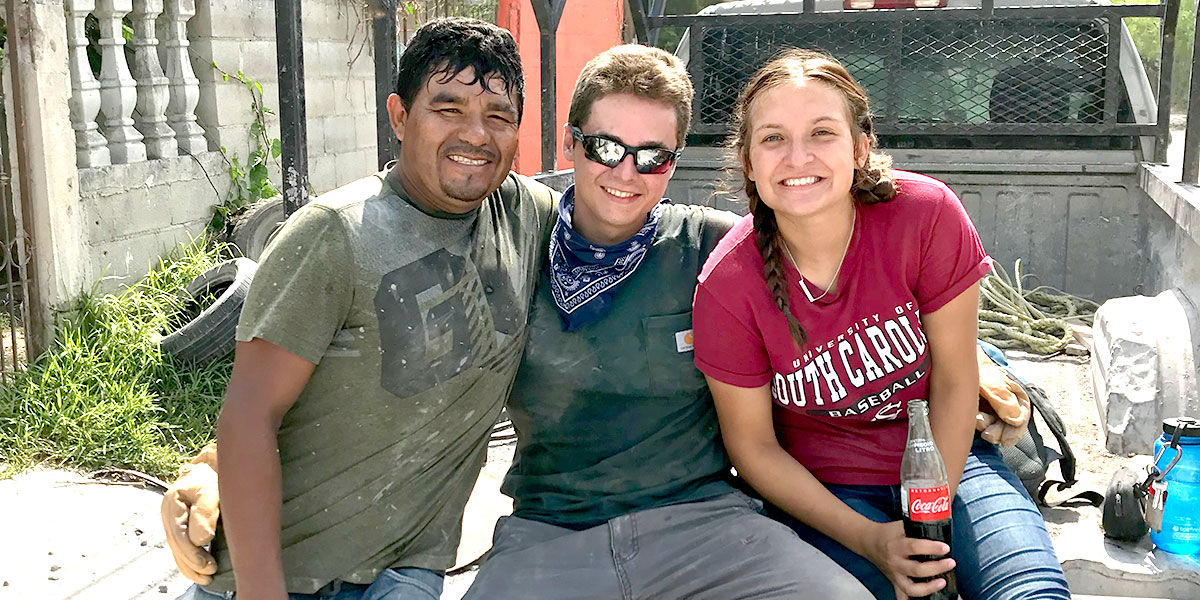Interns Pearce and Sofia with their friend in Reynosa