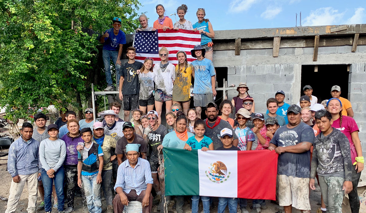 A team from North Carolina with the local staff and volunteers pouring a roof on 4th of July in Reynosa Mexico