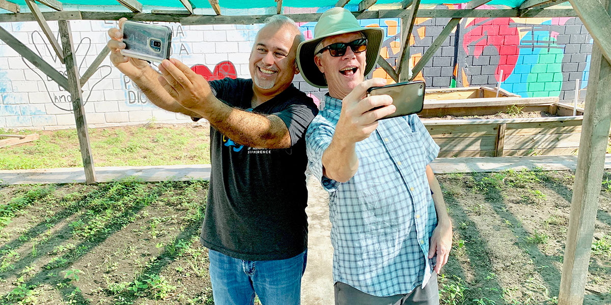 David and James taking selfies at the garden in Naranjito