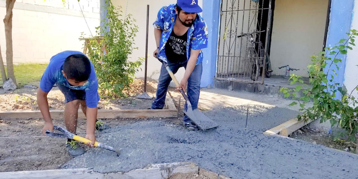 Pouring sidewalks at the complex in Naranjito