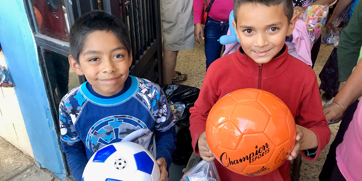 Kids in Reynosa with their brand new soccer balls at the Christmas fiesta last year
