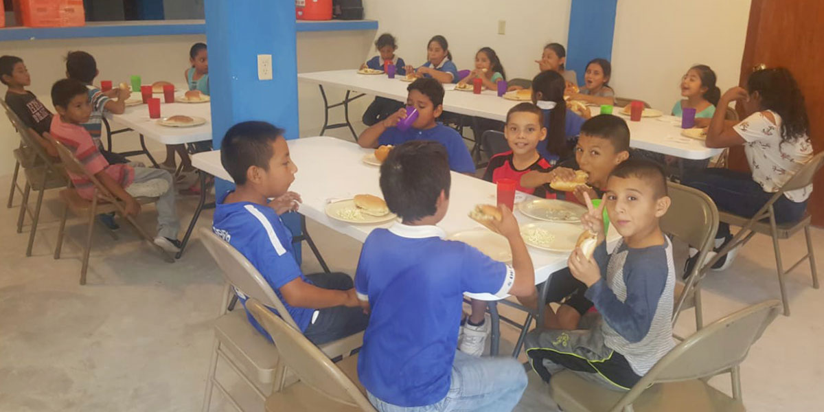 The kids enjoying a meal as part of the nutrition program at the new community center in Miguel Aleman