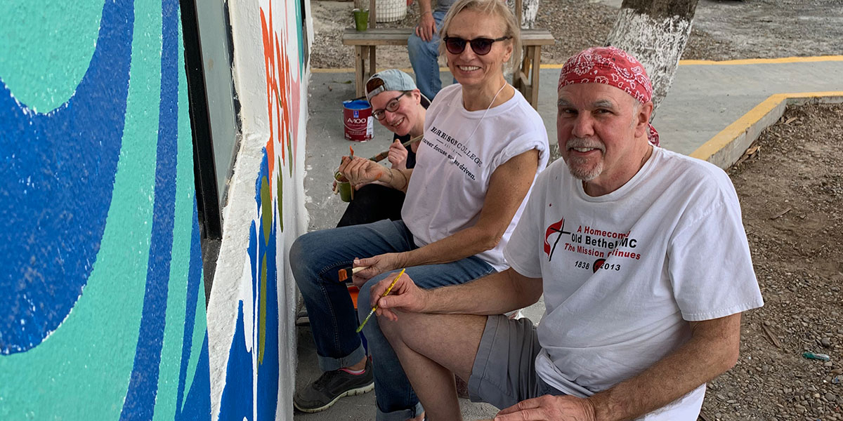 Friends from Indiana painting a mural in Naranjito Mexico