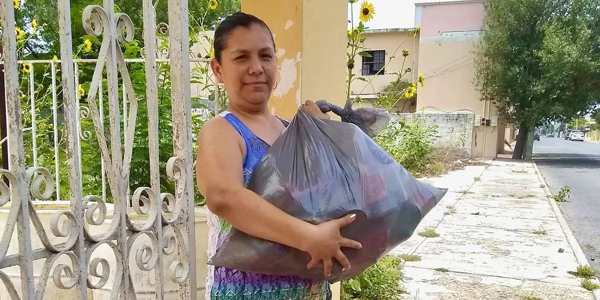 Distributing grocery packages to families in need in Miguel Aleman