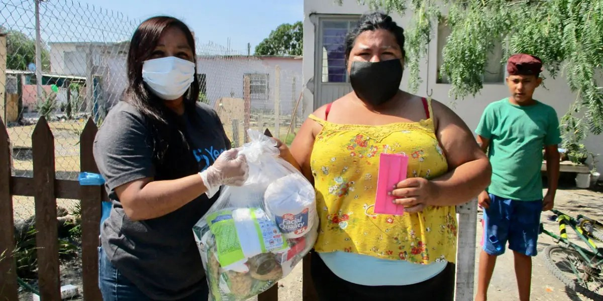 Distributing grocery packages to families in need in Reynosa
