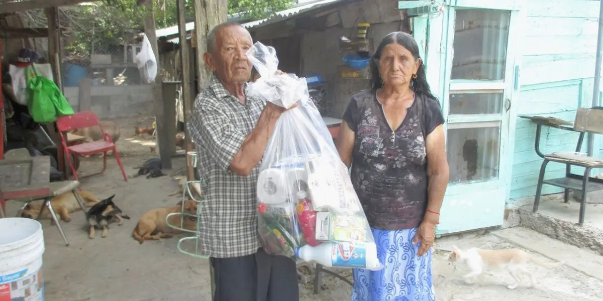 Delivering grocery packages to families in Miguel Aleman