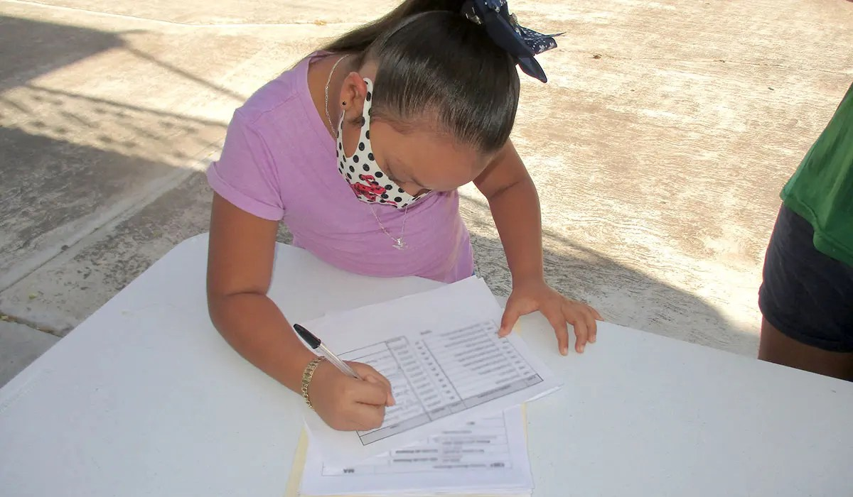 Distributing scholarships to the students in our scholarship program in Mexico