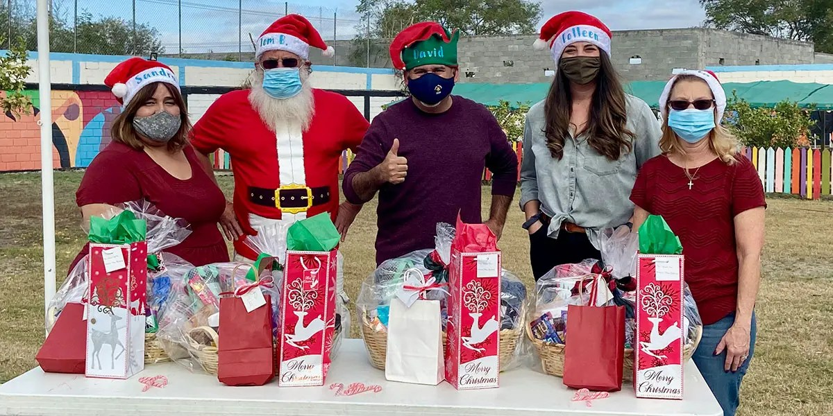 The McAllen staff with friends at our safe Christmas fiesta