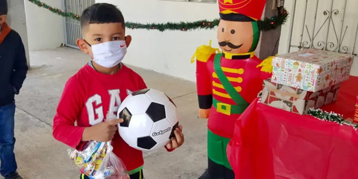 A kid receiving a soccer ball for Christmas in Miguel Aleman Mexico