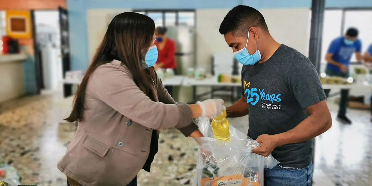 The staff in Reynosa preparing grocery packages for families
