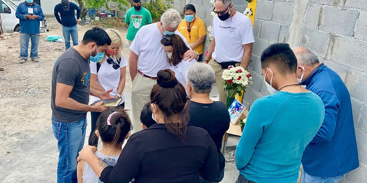 Praying over the family of Casa 3 in Reynosa Mexico