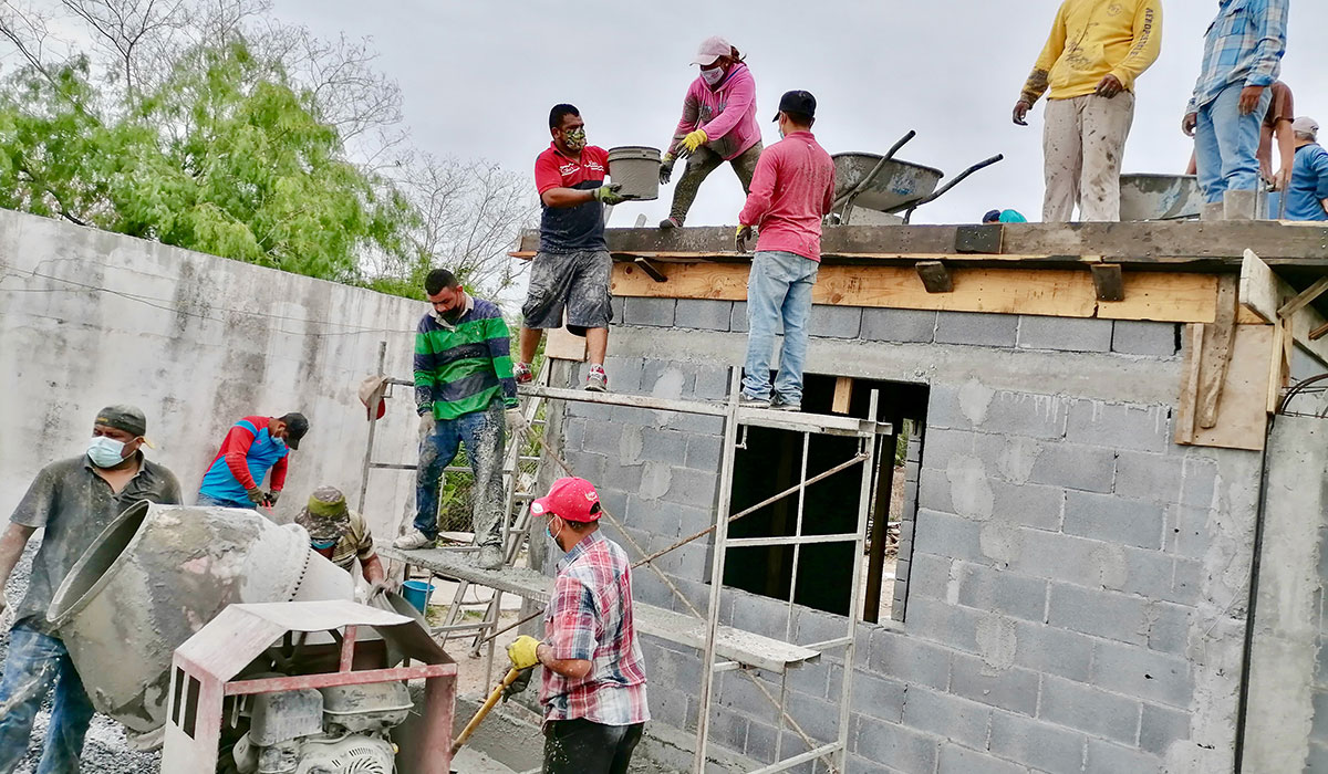 Our staff and volunteers in Reynosa Mexico pouring the roof of Casa 2