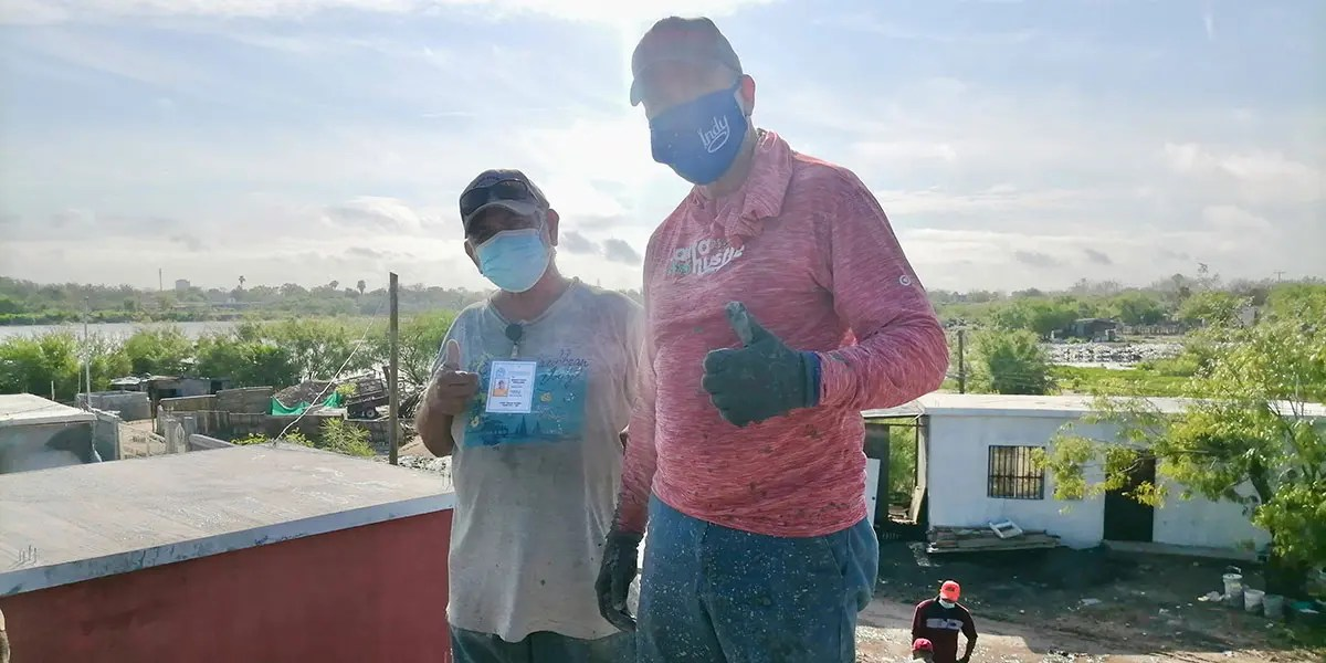 Our Board member Tom with Beto at the roof pour of Casa 3 in Reynosa Mexico