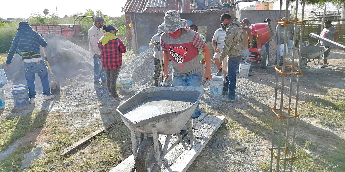 Our staff and volunteers pouring the floor of Casa 5 in Reynosa Mexico