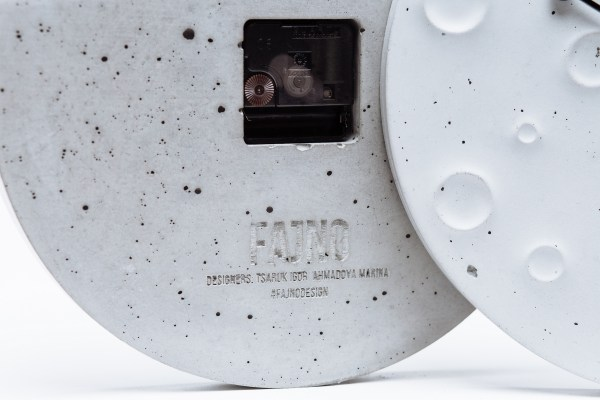 "Wall clock made of concrete in the form of the moon ""Around the Moon in 60 Minutes"""