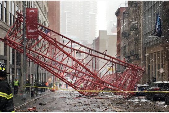Debris and a mangled crane lie in a street in Lower Manhattan following a deadly collapse on Feb. 5.