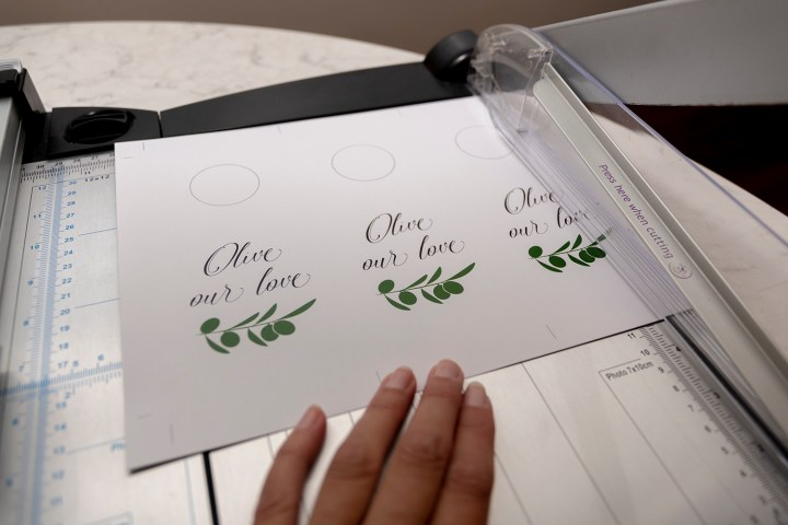 Use paper cutter to cut out Free Printable Olive Oil Bottle Tags from Faking it Fabulous