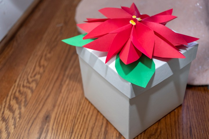 A Paper Poinsettia Holiday Gift Wrapping Idea