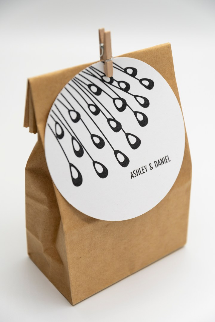 Free modern peacock feather favor tags in black and white
