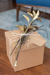 Kraft paper box embellished with gold spray painted branches and leaves