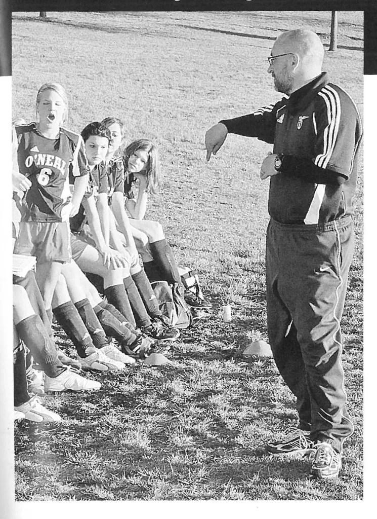 Coach Kyle Keigel talks with the 2006 girls soccer team.