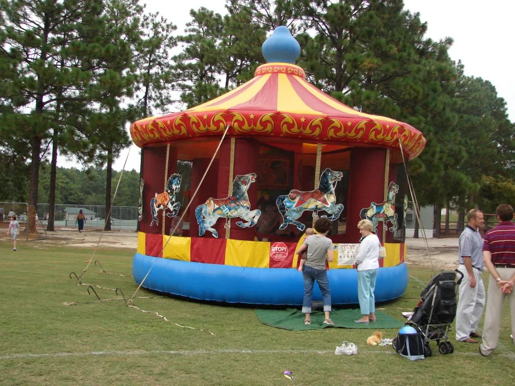 Many of O'Neal's ground breaking ceremonies took place at the annual picnic.. It also called for extras like a bouncy house. This was the 2006 picnic where the ground breaking for McMurray Lower School happened.