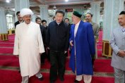 President Xi Jinping visiting a mosque in the city of Urumqi in 2014