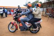 CEO Rwanda Electric Mobility and Environment Minister of Rwanda takes a ride on the electric converted motorcycle