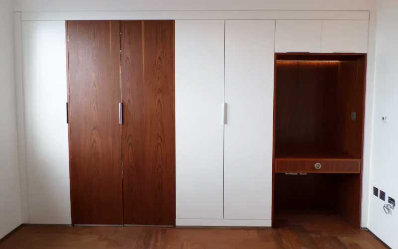 Timber-hidden-door-and-desk-unit