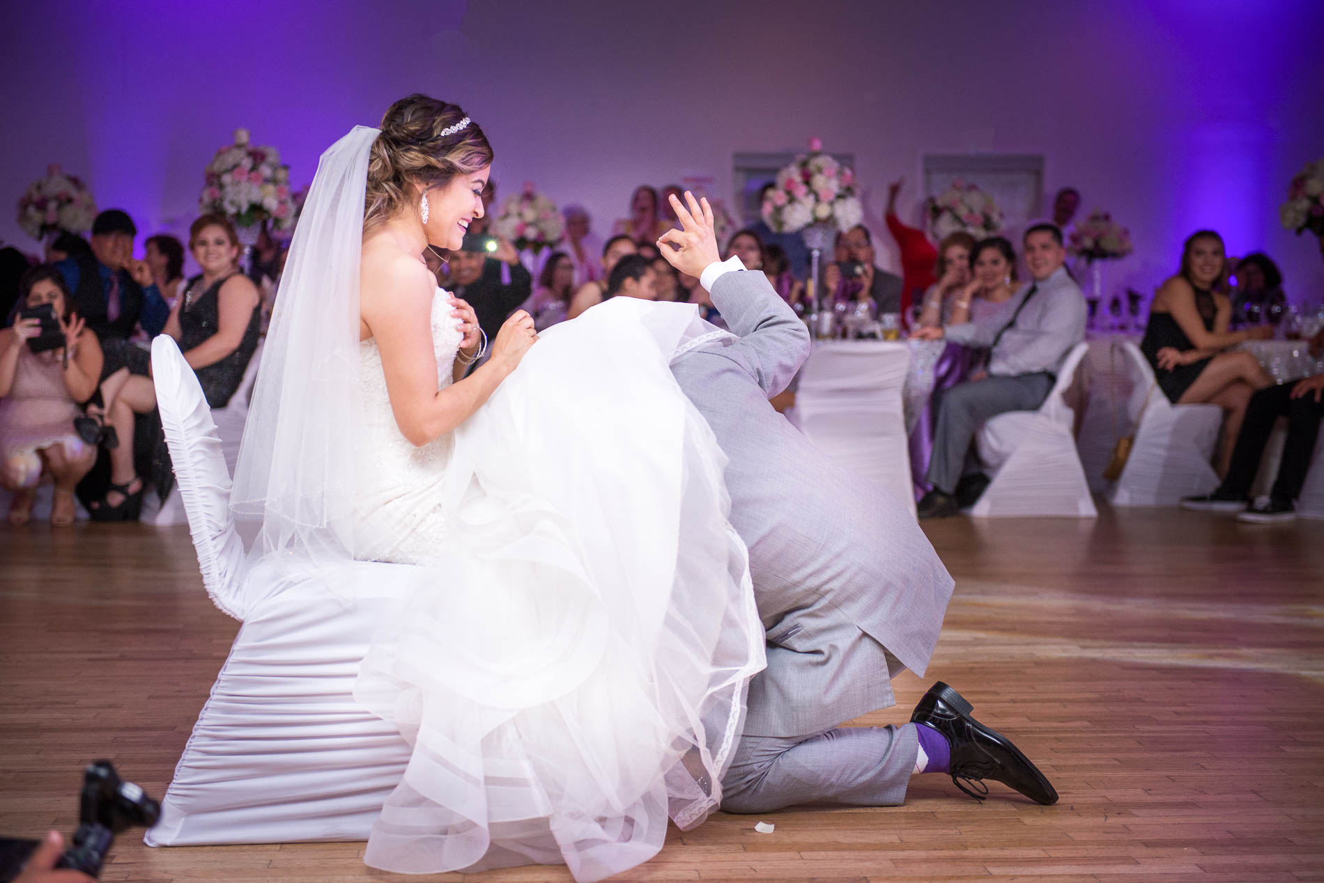 19 Of The Best Wedding Garter Removal Songs For Your Reception