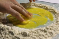 mixing the flour and egg