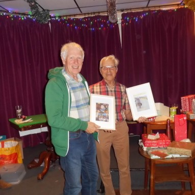 two framed copies of the Christmas newsletter which he has produced this year and last.