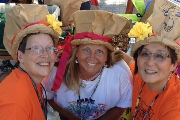 Volunteers Show Off Their FAMEous Paper Bag Hats