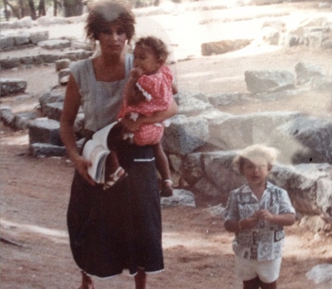 Katina Holmes carrying young Theodora Holmes and with Alex Holmes